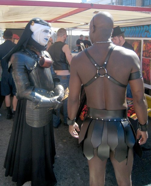 nun and ebony hunk at folsom st fair.jpg