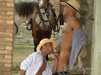 Nicos Casanova and Renato Lima are riding horseback when blonde Robert McDougal spots them resulting in Nicos and Renato double penetrating Robert