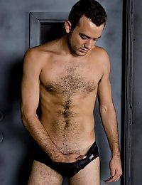 Hot hairy stud gets naked and takes everything off